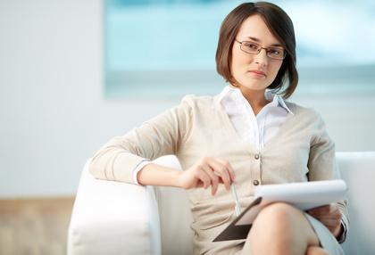 Woman Therapist in Chair | Denver CO Therapist